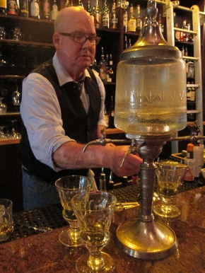 Peche bartender preparing the absinthe louche
