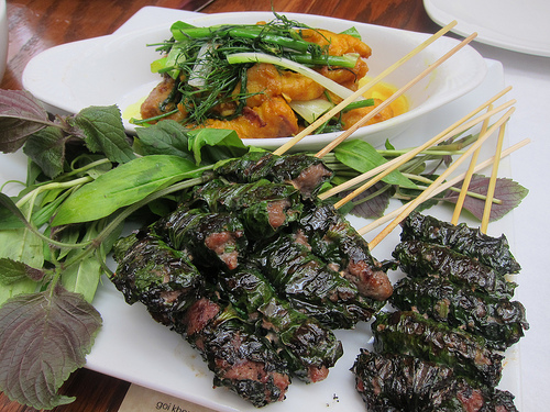 cha ca thanh long - grilled turmeric catfish & bo la lot - grilled beef wrapped in betel leaves