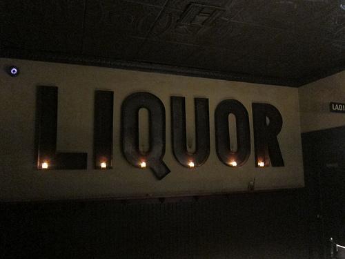 giant liquor sign