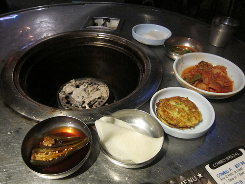 banchan around the charcoal grill