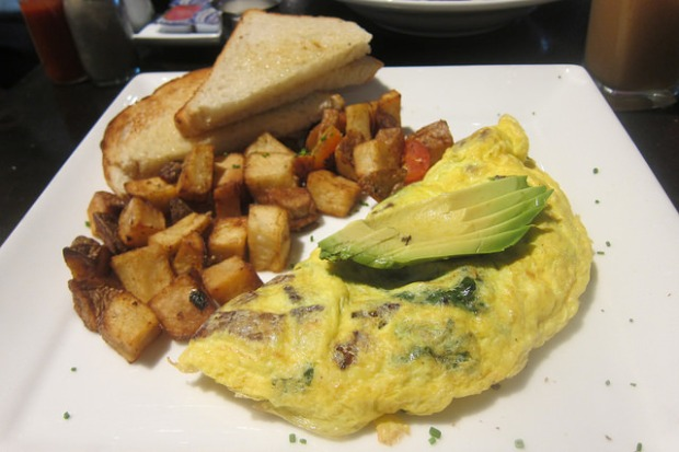 sausage and spinach omelet with avocado