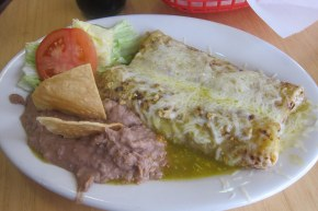 Plato Especial - two burritos covered in cheese and salsa