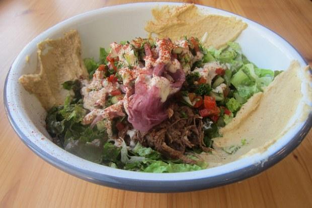 braised short ribs over salad greens